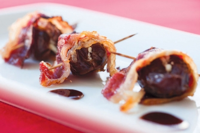 Dates stuffed with goat cheese wrapped in beef bacon.